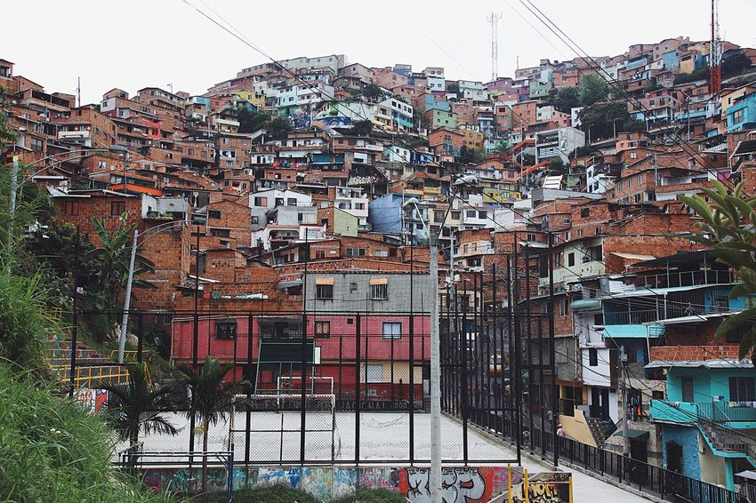 Comuna 13 Southamerica Colombia Medellín Comuna 13 Adventure Cityadventure Passion Football Building Exterior Architecture Built Structure Building Day City No People Outdoors House Multi Colored Travel Destinations Residential District Adventures In The City