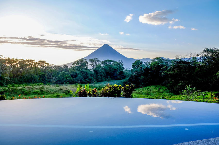 Arenal  Arenal Volcano National Park Costa Rica Beauty In Nature Cloud - Sky Cone Cone Shape Cone Shaped Costarica Day Landscape Mountain Nature No People Outdoors Scenics Sky Tranquil Scene Tranquility Tree Volcano Water