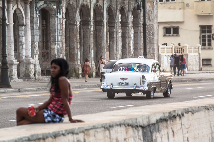 Havana, Cuba. Daily life along Malecòn. Architecture Building Exterior Car Cuba Cuban Havana Lifestyles Malecón, La Habana Person Street Transportation Travel Young Adult