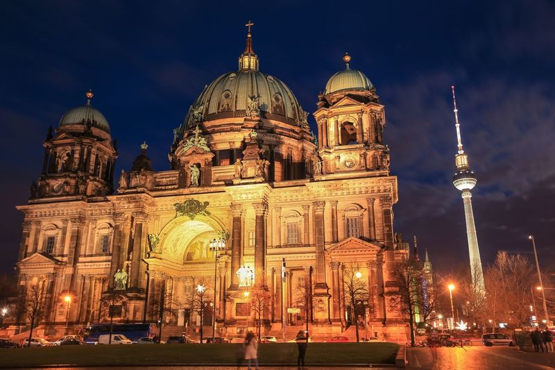 Berlin cathedral against sky in city at night