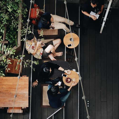 High angle view of people sitting in toys