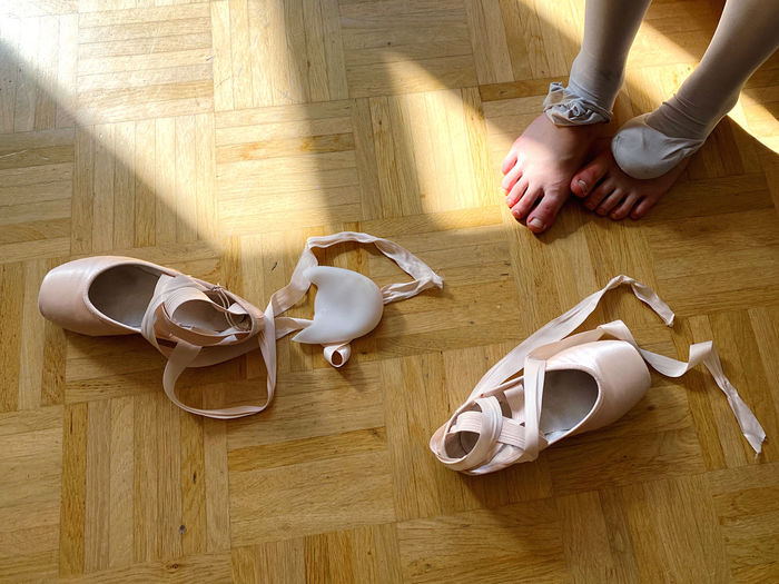 High angle view of girls foot after ballet class