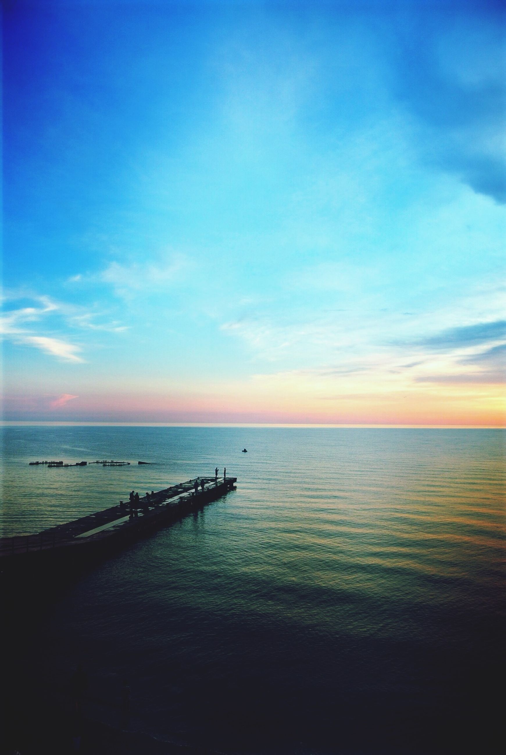 sea, horizon over water, water, tranquil scene, sky, scenics, tranquility, beauty in nature, sunset, beach, nature, idyllic, blue, cloud - sky, shore, cloud, calm, outdoors, seascape, reflection
