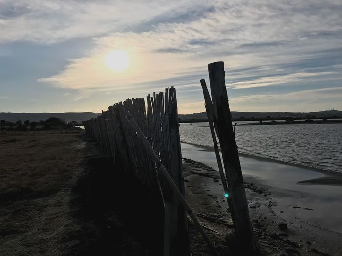 Beach Beauty In Nature Wood - Material Fence Barrier No People Sunlight