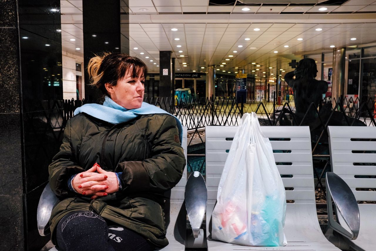 one person, real people, men, sitting, bag, adult, three quarter length, shopping, indoors, lifestyles, casual clothing, incidental people, illuminated, retail, business, clothing, males, leisure activity, plastic bag, warm clothing, consumerism, retail display