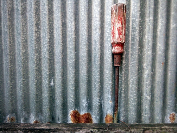 EyeEm Selects Metal Corrugated Iron No People Day Full Frame Backgrounds Outdoors Close-up Screwdriver Old Wood - Material Zinc Wave Zinc Fence Zinc Rust Rust Object Object From Nowhere Patterns & Textures Objects Of Interest Red Noise Art Is Everywhere Artistic Photo