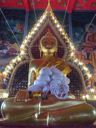 Statue of illuminated temple in building