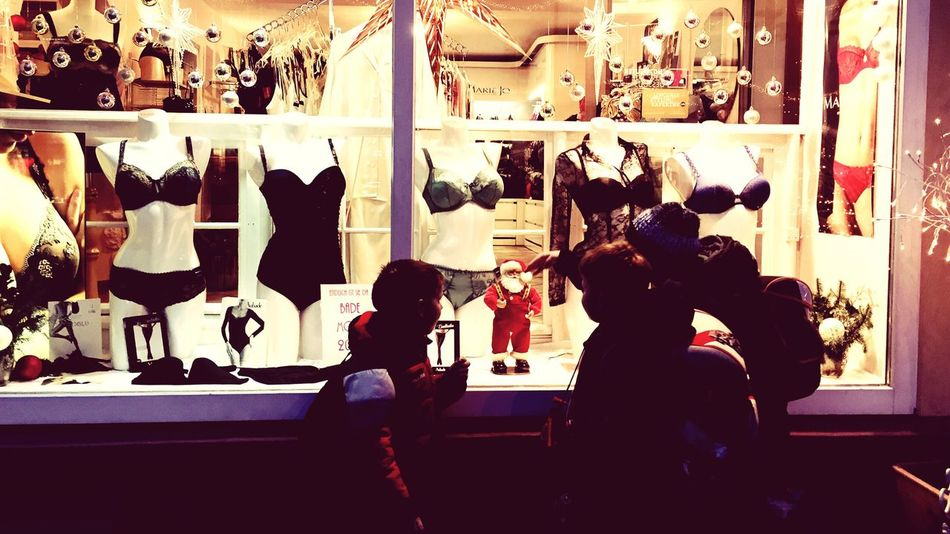 Kids watching dancing Santa in a Dessous shop. Children Santa Dessous Dancing Kids Photooftheday Christmas Picoftheday Better Look Twice The Tourist The Street Photographer - 2016 EyeEm Awards