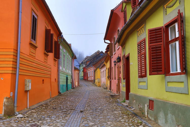 City of Sighisoara Alley Architecture Building Exterior Built Structure Cobblestone Color Splash Dracula Eyem Best Edits Eyem Gallery Narrow Old Town Romania Street The Way Forward Town UNESCO World Heritage Site Vanishing Point Window The Street Photographer - 2016 EyeEm Awards