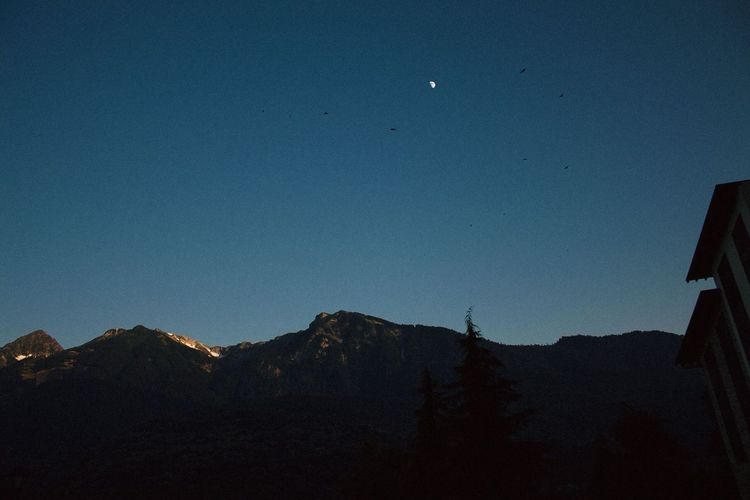 Sky Moon Mountain Scenics - Nature Beauty In Nature Night Tranquil Scene Tranquility No People Nature Blue Dusk Mountain Range Space Astronomy Low Angle View Copy Space Clear Sky Outdoors Silhouette Full Moon Snowcapped Mountain Planetary Moon