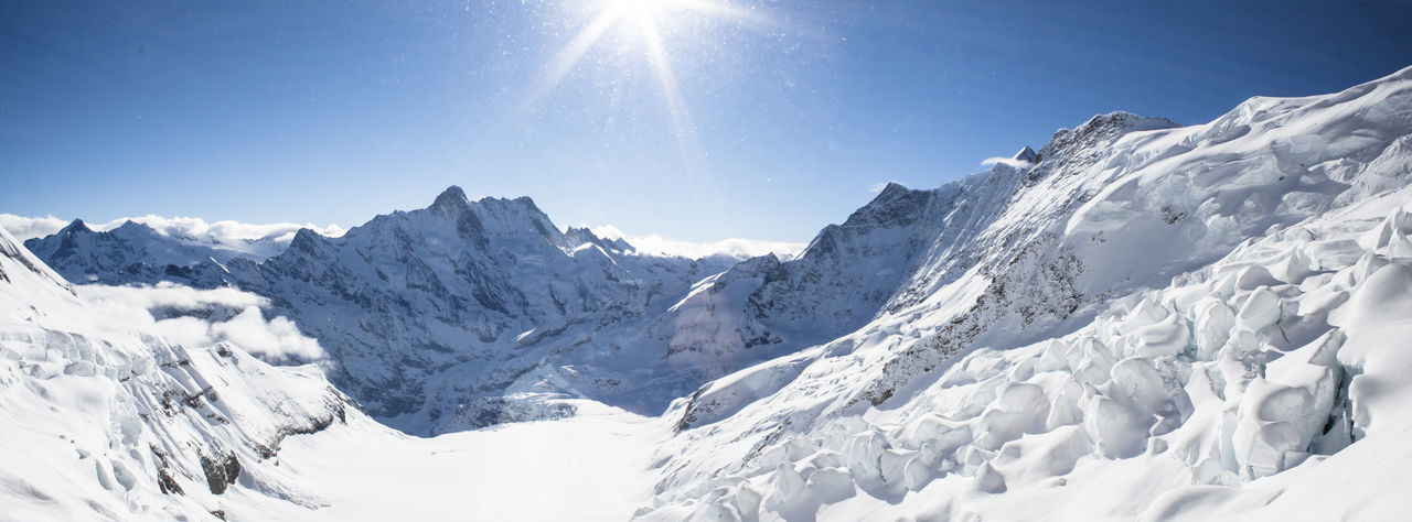 Snow Cold Temperature Sky Winter Scenics - Nature Beauty In Nature Nature Sunlight Mountain Tranquil Scene Sun Environment White Color Landscape Mountain Range Tranquility No People Panoramic Mountain Peak