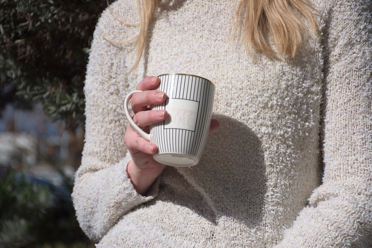 Drink One Person Holding Cup Refreshment Mug Drinking Coffee Cup Hot Drink Coffee - Drink Close-up Coffee Sweater Midsection Adult Women Hand Outdoors Blond Hair Fingers