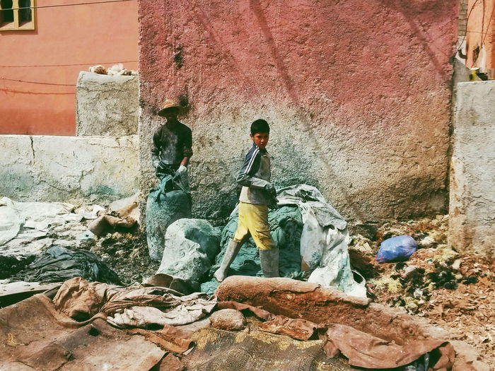 Marrakech Tannery Child Worker Work Leather Tanners Tannery Morocco Marrakech People Building Exterior Street Day Explore Streetphotography Travel Destinations Outdoors Person