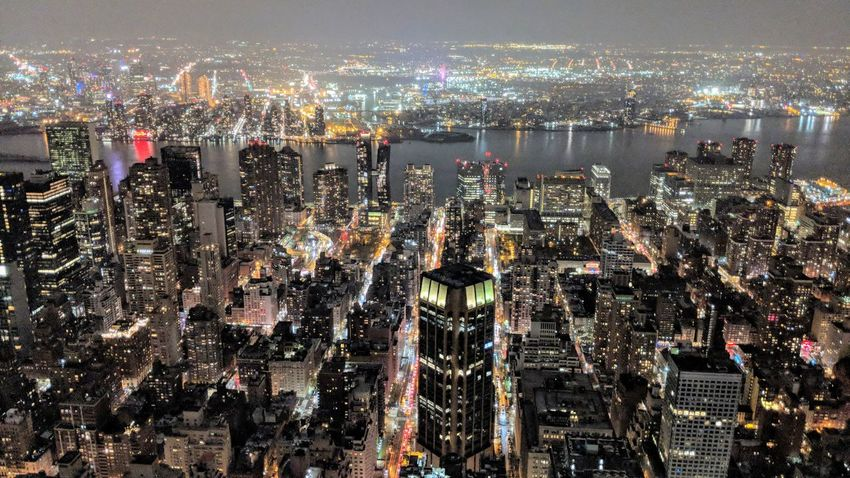 View of NYC from the 86th floor of Empire State Building Downtown New York City New York Empire State Building Skyscraper Architecture Night Nightphotography Night Photography Travel Travel Photography Travel Blogger Good Times Followme Pixelxl2 Cityscape City Water Illuminated Sky Building