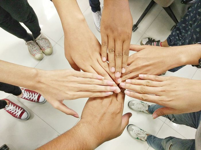 Human Body Part Human Hand Togetherness Teamwork Connection People Unity Only Women Day Adult Friendship Indoors  Adults Only Close-up Young Adult