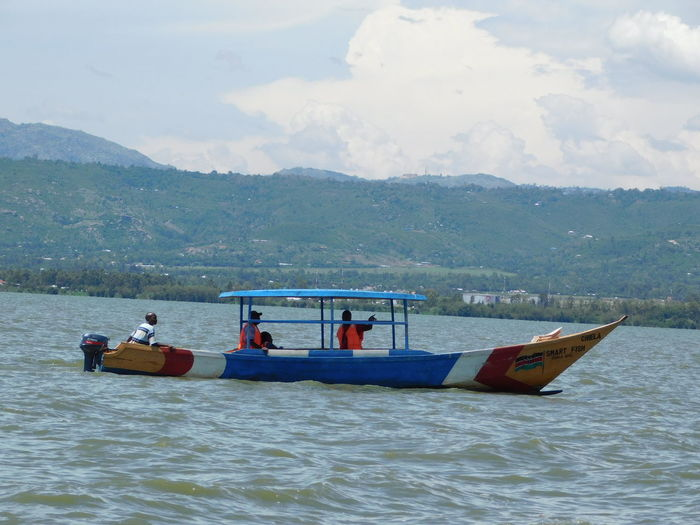 Nautical Vessel Transportation Day Mountain Outdoors Men Adult Nature Water Lake Sky People Adults Only Only Men Boat Mountain Range Lake Waters Perspectives On Nature