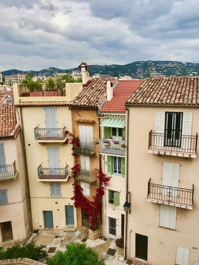 City in France - Cannes. Houses Apartment Architecture Building Building Exterior Built Structure City Cloud - Sky Color Day House Nature No People Old Outdoors Plant Residential District Roof Roof Tile Sky Sunlight Town TOWNSCAPE Tree Window