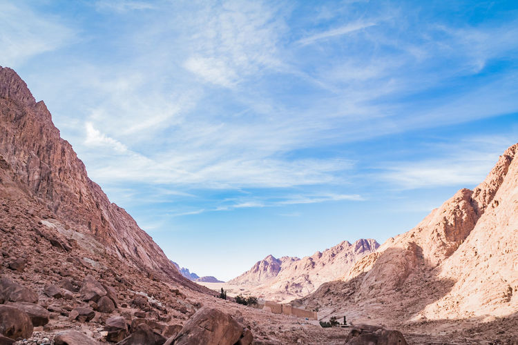 Sinai Hiking Adventure Sky Scenics - Nature Beauty In Nature Mountain Rock Cloud - Sky Environment Nature Mountain Range Tranquil Scene Landscape Non-urban Scene Rock - Object Tranquility Day Rock Formation Solid No People Arid Climate Physical Geography Climate Outdoors Formation Eroded