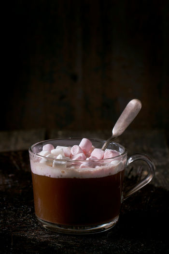 Glass cup of Hot chocolate with melting marshmallows and vintage silver spoon over old wooden table. Dark rustic style. Beverage Chocolate Coffee Dark Dessert Marshmallow Pink Dark Background Drink Foam Food And Drink Foodphotography Glass Hot Chocolate Hot Drink Mug Sweet