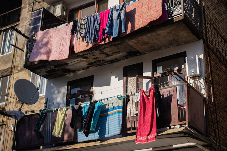 City Life Georgia Kutaisi Shadow And Light Summertime Balcony Building Exterior Built Structure Clothesline Clothing Day Drying Laundry Light And Shadow Linen Multi Colored No People Outdoors Satellite Dish Store Summer