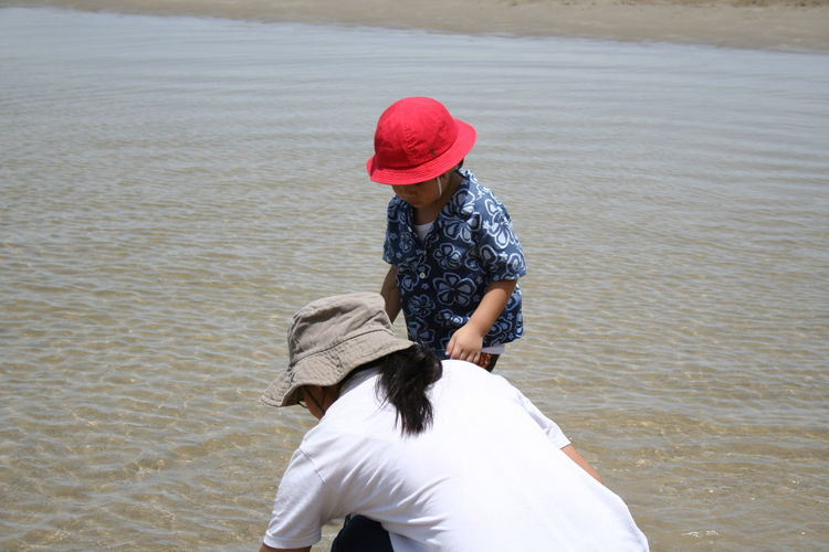 Women with son on shore at beach