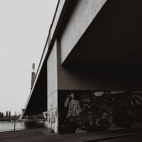 Outdoors Modern Bridge - Man Made Structure Connection Architecture Lines Pattern Building Exterior Graffiti Black & White Built Structure No People Day Street Art Spray Paint
