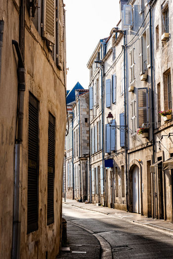 Scenic view of narrow street in the historic centre of la rochelle, france