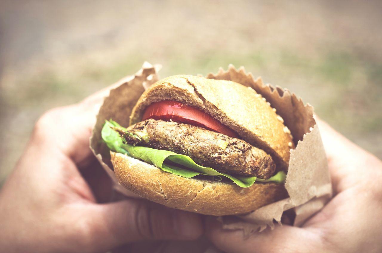 Close-up of hands holding hamburger