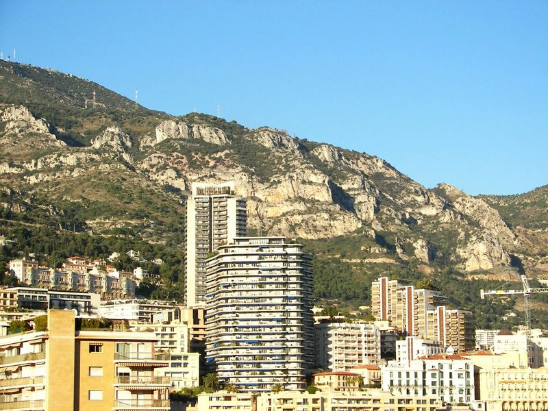 Showcase: February Monaco France Tranquil Scene No People Architecture Eye4photography  Travelphotography Famous Place Travel Photography Tranquility Natural Beauty Blue Sky EyeEm Gallery Perspective From My Point Of View Day EyeEm Best Shots Outdoors Apartment Buildings Mountains Building And Sky Building Monaco Traveling Mountain View