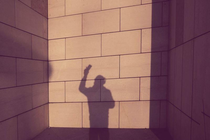 No signal? One Person One Man Only People Outdoors Day Architecture Smartphone Signal Sunlight Streetphotography Backgrounds Mobile Conversations Shadow Shadows & Lights Wall