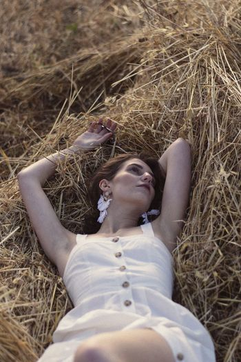 Young woman lying down on land