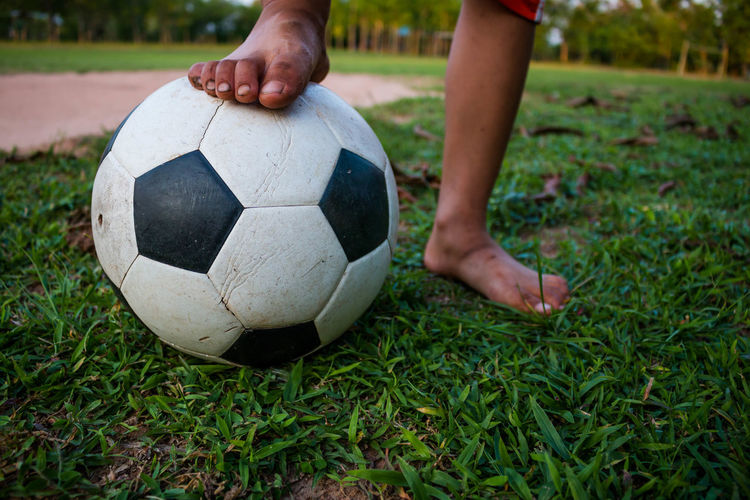 Adult Ball Close-up Grass Human Body Part Human Hand Low Section Men Outdoors People Playing Soccer Soccer Ball Soccer Field Soccer Player Soccer Shoe Soccer Uniform Sport Sportsman