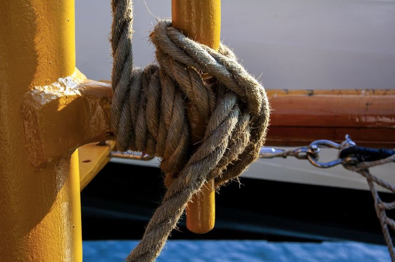 Close-up of rope tied up on metal