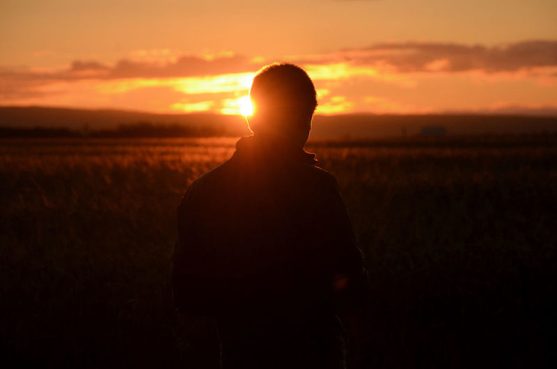 Drone pilot at work Agriculture Drone  EyEmNewHere Orange Tranquility Cereal Plant Drone Pilot Field Landscape Men Nature One Men One Person Orange Color Outdoors People Pilot Scenics Silhouette Sky Sunrise Young Adult Young Men Love Yourself