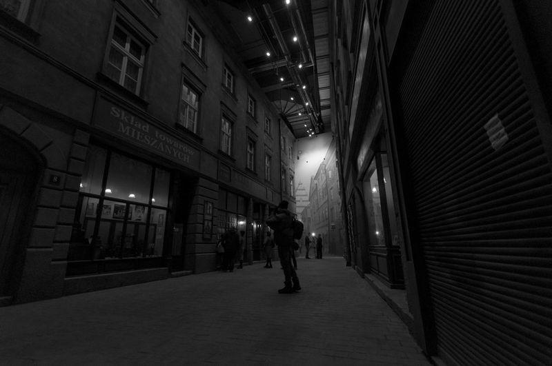 Man walking in illuminated city at night
