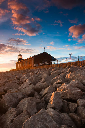 Lighthouse at sunset Great Britain Historical Building Light Lighthouse Morecambe Bay  Pier Architecture Bay Building Exterior Built Structure Danger Dusk Evening Morecambe Nature No People Ocean Outdoors Sea Sky Sunset