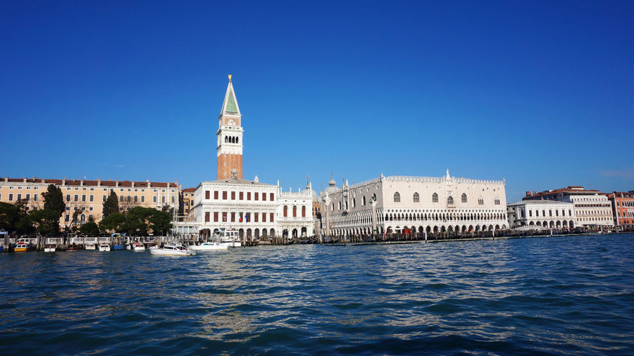 Church of san giorgio maggiore and doges palace by grand canal in city