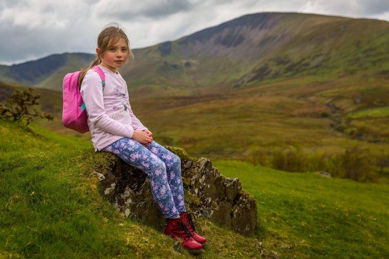 Portrait Of Smiling Girl On Landscape