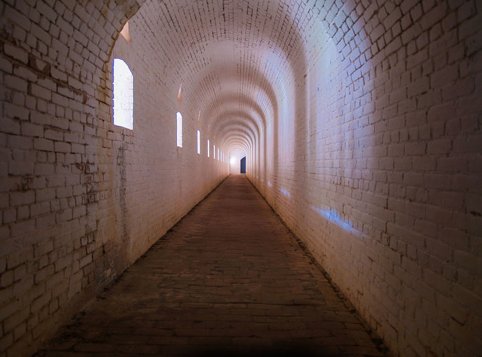 Arch Architectural Column Architecture Brick Wall Building Built Structure Corridor Day Diminishing Perspective Empty Historic Illuminated Long Narrow No People The Way Forward Tunnel Vanishing Point Walkway