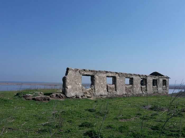 Abandoned built structure against clear sky