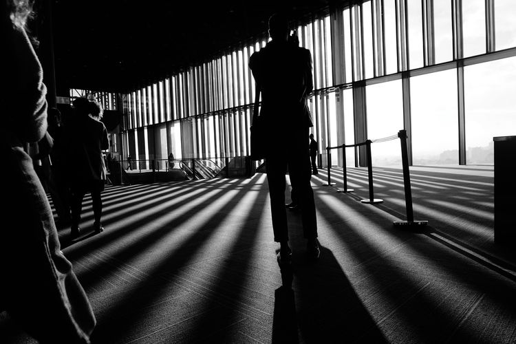 Rear view of silhouette people walking in airport