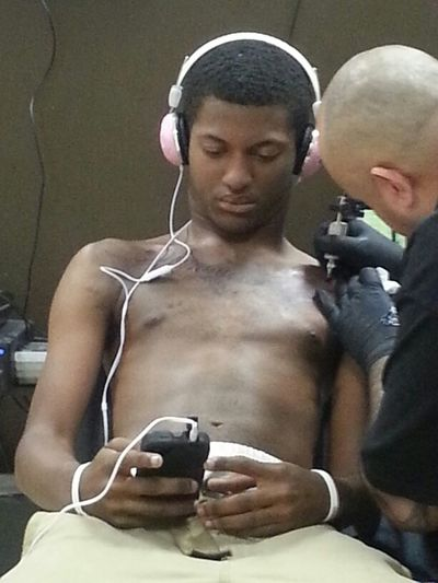 Hanging out with my son getting his chest piece