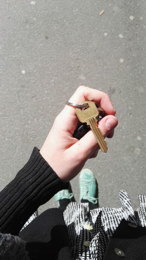 Close-up of womans hand holding key