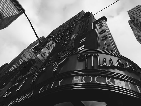 Showplace of the Nation Blackandwhite Photography NYC Newyorkcity EyeEm Radiocitymusichall Radiocity Low Angle View Architecture Building Exterior Built Structure Sky Day Outdoors