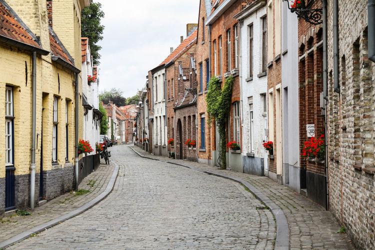 Footpath amidst buildings in town