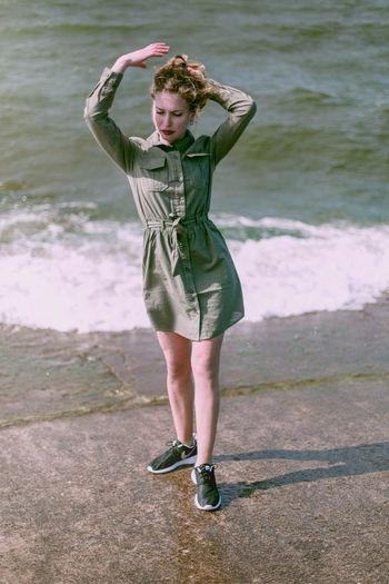Full length portrait of woman standing on beach
