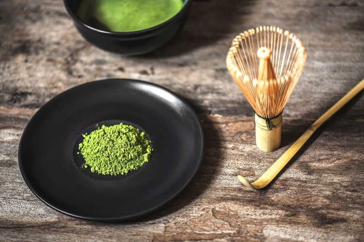 Green Tea Powder In Bowl On Table Green Bowl Hot Drink Matcha Green Tea Tea High Angle View No People Green Tea Matcha Tea Indoors  Still Life Tea Table Black Color Green Color Food And Drink Close-up Ceremony Tea Ceremony Ground - Culinary Directly Above Household Equipment
