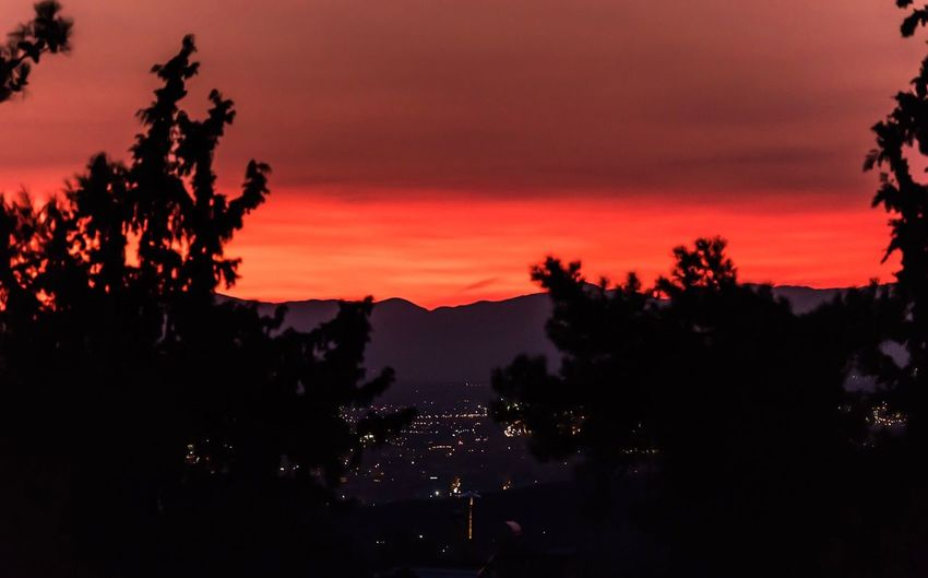 Sunset Silhouette Tree Nature Beauty In Nature Landscape Sky Mountain Scenics Outdoors No People Red Sunset City City View  City View From Mountain
