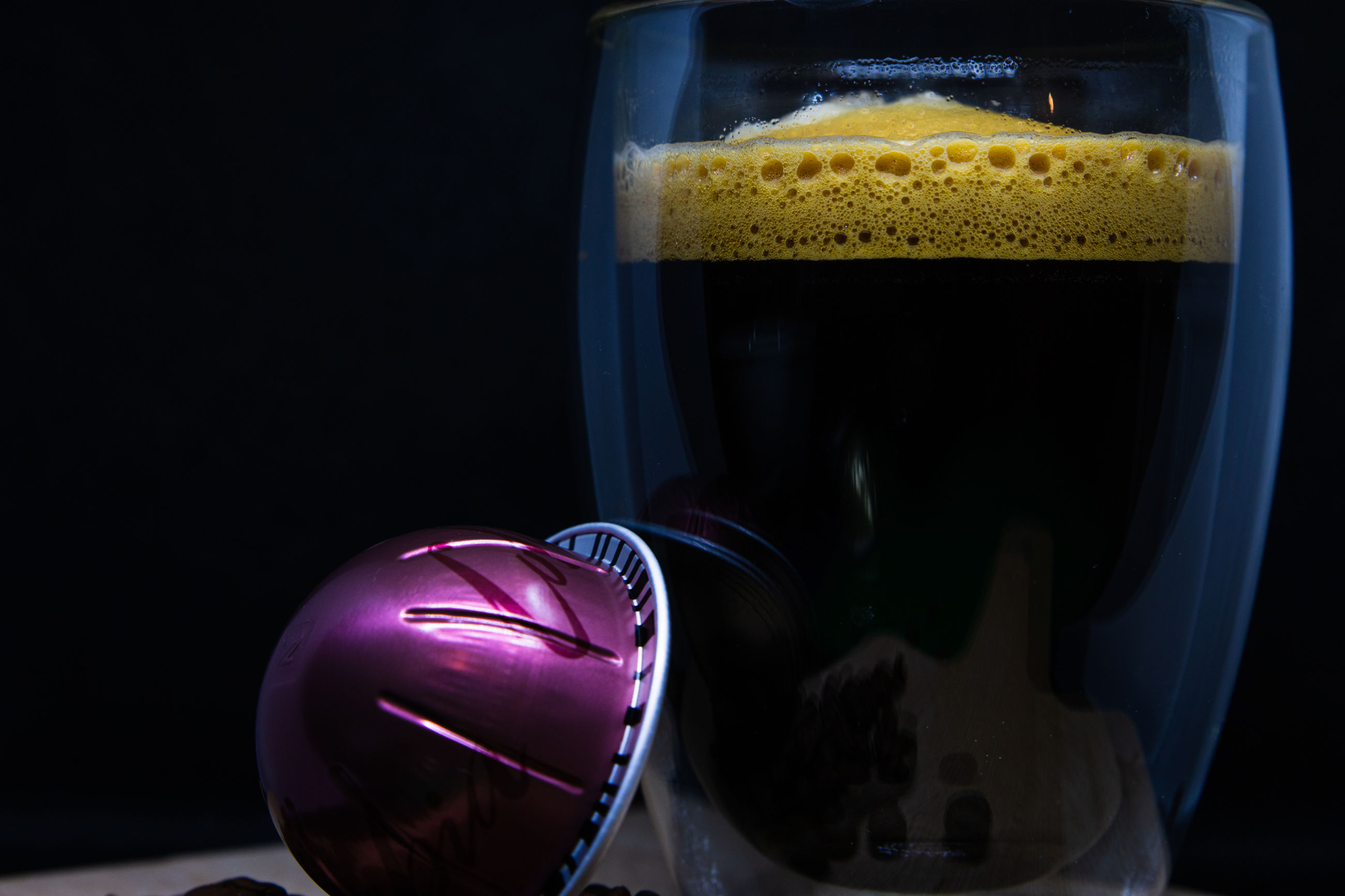 still life, close-up, indoors, drink, refreshment, no people, food and drink, transparent, studio shot, glass, black background, freshness, alcohol, glass - material, frothy drink, household equipment, focus on foreground, drinking glass, coffee, purple