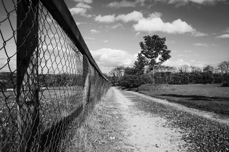 Country Road Country Road Black White Dirt Countryside Nature Campsite Meath Irish Military War Museum Empty Space Peace Quiet Sand Gravel Grassland Firld Agricultural Land Tree Sky Cloud - Sky Chainlink Fence Fence Wire Mesh Crisscross Boundary